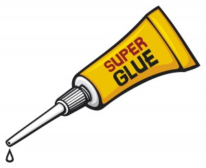 metal tube of super glue